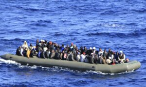 Migrants found suffocated in crowded vessel, as 400 are saved near Italy