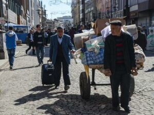 Turkish Kurds go home to war-ravaged city of Diyarbakir as curfew lifted