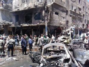 Damascus bombings: At least 20 killed as twin blasts hit Syrian capital suburb